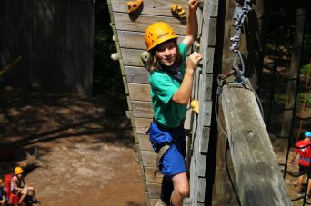 Halfway up the climbing wall